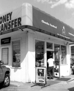 "Storefront payday lenders, like the ones shown here, offer money to people who wouldn't otherwise get it--but charge interest rates their critics call ""usurious."""