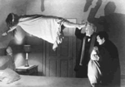 Flygirl: Linda Blair gets uppity while Max Von Sydow, center, and Jason Miller watch on in The Exorcist.