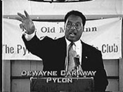 "Dwaine Caraway (whose name is misspelled above in a caption from a recent DCTV broadcast) says of his critics: ""Eventually we are going to have to exterminate them."""
