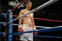 In a corner stands a boxer, Mark Wahlberg.