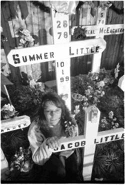 "Stacey Hassler by the crosses that memorialize her daughter Summer Little and Summer's unborn son, Jacob. ""Out here, you don't dwell on the negatives."""