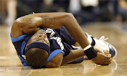 First Nowitzki gets knocked down, then Dampier falls to the floor, and here it&amp;#146;s Josh Howard down with a twisted ankle in Game 1 of the Denver series.