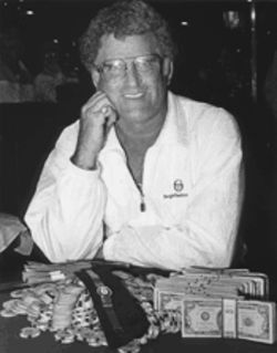 Cloutier with his mound of chips and cash, as well as his first-place watch, from his Hall of Fame win in 1990