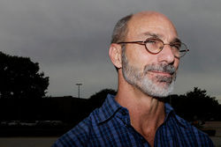 Steven Phillips served 24 years in prison for a sexual assault he didn't commit. Now free, he stands to receive $4.1 million in restitution from the state but is suing his former lawyer, Kevin Glasheen, who claims he's owed a quarter of that amount.
