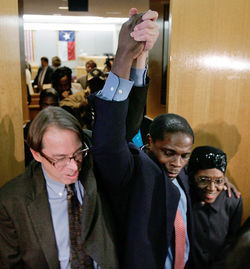 "Innocence Project of Texas chief counsel Jeff Blackburn (left) celebrates with Charles Chatman in 2008 as Chatman leaves a Dallas courtroom cleared of a wrongful rape conviction that put Chatman behind bars for 27 years. Chatman paid Glasheen 25 percent of the money he received from Texas in compensation post-exoneration. Blackburn, meanwhile, has collected hundreds of thousands of dollars in ""referral fees"" for sending Innocence Project clients to private lawyers."