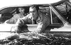 Tommy Lee Jones drives Ashley Judd into the drink after realizing he's already made this movie -- like, two times before.