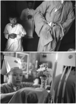 While Trung Han Kien prays, left, Minh Huynh carries an offering of tea during a service at the temple in Mountain View. Below, Minh Huynh carries flowers, representing human reproductive cells, to the altar.