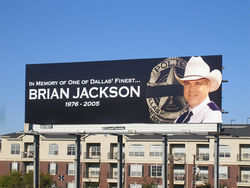 "A billboard suggested to passersby that Officer Brian Jackson's service to Dallas would not be forgotten—nor would his killer, the man who, prosecutors argued, broke the ""thin blue line"" between law-abiding citizens and chaos."