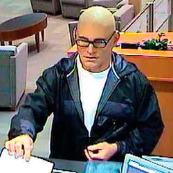 Surveillance footage of Milam in his mask at American National Bank and Bank of America.