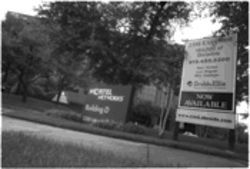 "A ""for lease"" sign outside telecommunications giant Nortel Networks serves as a nagging reminder of hard times in Richardson's Telecom Corridor."