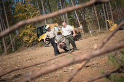 Cherokee County Sheriff's deputies drag a protester who had tied himself to heavy equipment used to clear the Keystone XL's path through East Texas.