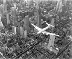 "It's a bird. It's a plane. It's Margaret Bourke-White's ""A DC-4 flying over New York City, 1939."""