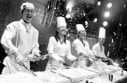 Mind the fingers: These chefs get choppin',  Cookin' and groovin'--all without injury, we  hope.