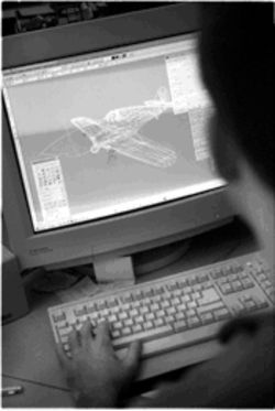 Kevin Rivas, one of WWII Online's graphic artists, updates one of the game's aircraft. Periodically, the weapons and vehicles in the game are updated just as they were during the war. This not only adds authenticity but makes each side continually adjust to technological advancements, just as the military does in real life.