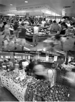 "Top: Shoppers leer at the expansive ""chef's case,"" which draws from a rotating roster of some 250 recipes. Bottom: A sample of the 15 fresh apple varieties in the produce cooler."