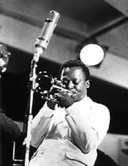 "Miles Davis on John Coltrane: ""He'd be standing up there [on the bandstand] when he wasn't nodding -- picking his nose and sometimes eating it."""
