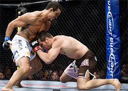 No place to hide: Vitor Belfort( left) pummels the heavily favored Rich Franklin into submission during the main event of the Ultimate Fighting Championship on September 19 before a sellout crowd at the AAC.