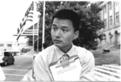 Dakun Sun suspects that the Chinese government is withholding his passport because he publicly practices Falun Gong in Dallas. Falun Gong practitioners say his case illustrates how China's persecution is beginning to infringe on the rights of U.S. citizens.