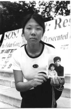 Danielle, a student at the University of Texas at Austin, holds a picture of herself with her father, Wang Zhiwen, who in 1999 was one of the first people in China convicted for practicing Falun Gong. While in prison, Danielle says, her father has been severely beaten, and she worries that he soon may be killed.
