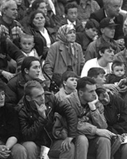 Kosovar refugees listen to announcements after arriving at Fort Dix, New Jersey, on Friday, May 7.