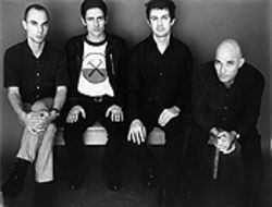 Why isn't this man smiling? Luna's Dean Wareham, second from left, is more than happy to tell you.