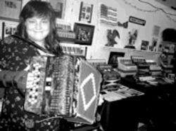 Natasha Geddie is suing former members of the  accordion group she helped to create.