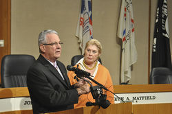Judge Foster and County Commissioner Maurine Dickey speak at a news conference marking the release of an investigator's report concerning alleged corruption by Constable Jaime Cortes. The news conference offered little insight into the investigation because neither of them read the report before facing the press.