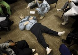 Ricardo Garcia plays the role of an unresponsive victim during a first aid class at the Army recruiting station in Oak Cliff.