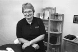 Massage therapist Lynn Street keeps her hands busy at Texas Instruments, where discount massages are one of the latest perks.